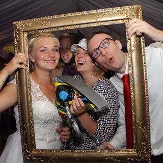 Bride and Groom posing with picture frame - Wedding DJ Kent, Ben Bell