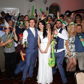 Bride and Groom, with guests, posing with dress up props - Wedding DJ Kent, Ben Bell