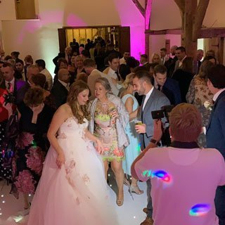 Bride and guests dancing to Kent Wedding DJ, Ben Bell