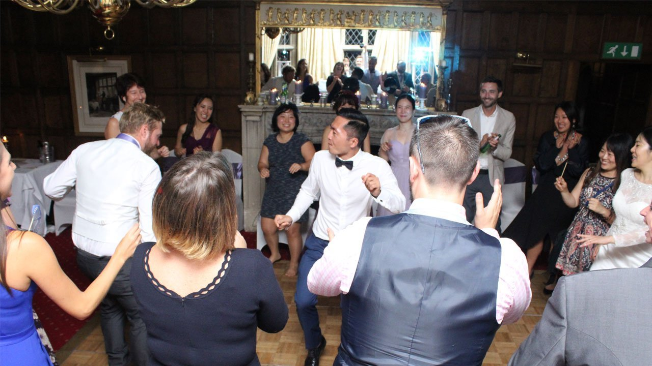 Groom and guests dancing at a wedding
