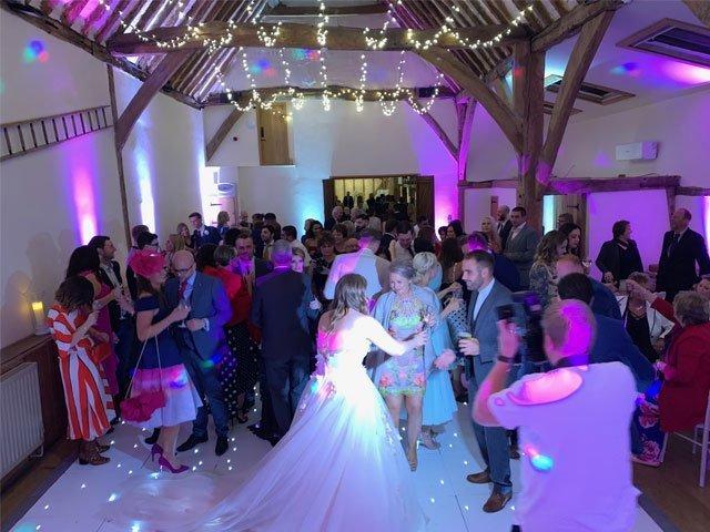 Bride and Guests Dancing to wedding DJ Ben Bell, Winters Barn, Kent